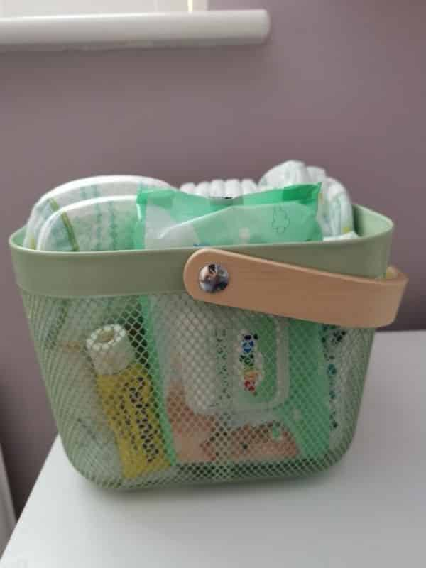 IKEA Risatorp metal basket for diapers and wipes - nursery hacks