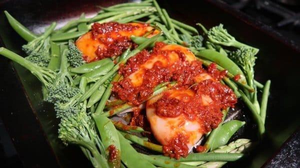 Harissa chicken and green veg traybake