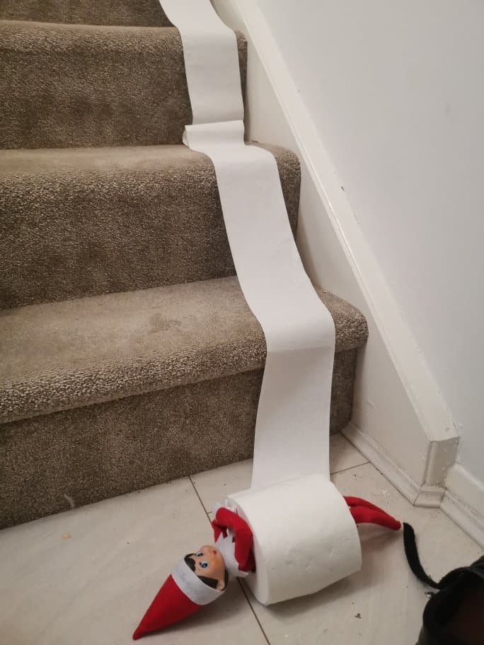 Elf on the Shelf ideas - Elf has rolled down the stairs in a toilet roll!