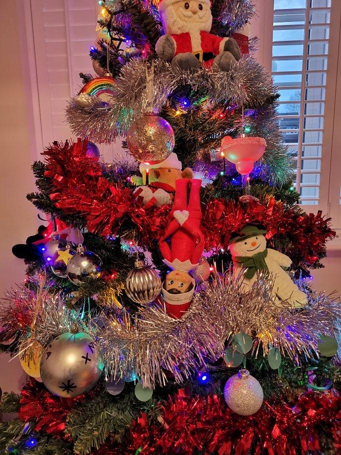Elf hiding in Christmas tree