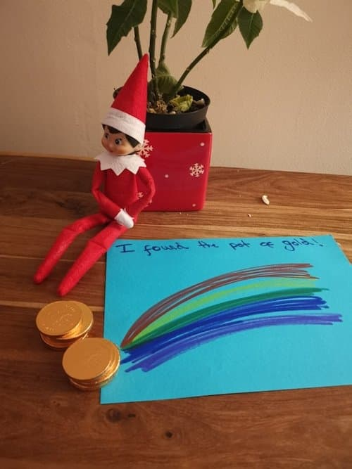 Elf on the Shelf finds gold chocolate at the end of the rainbow
