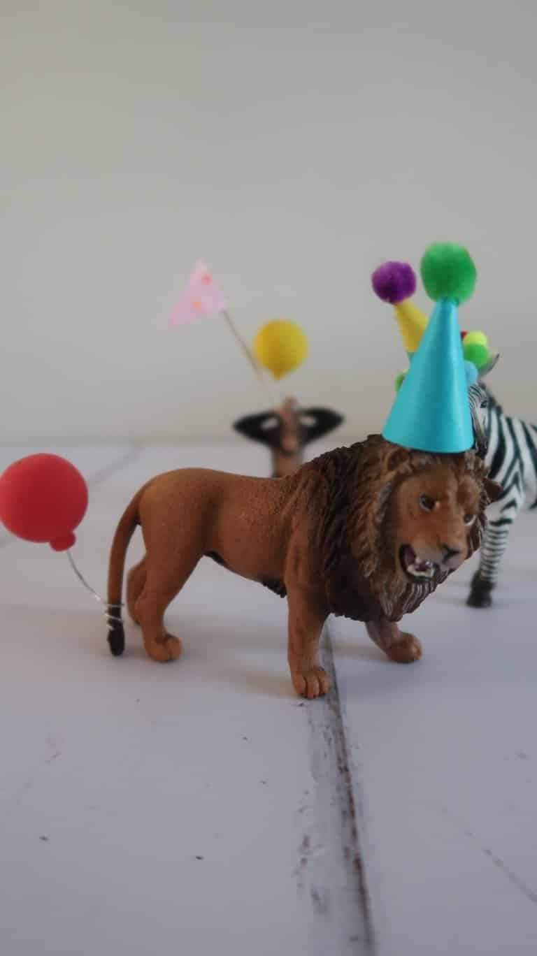 Party animal lion cake topper with party hat and balloon