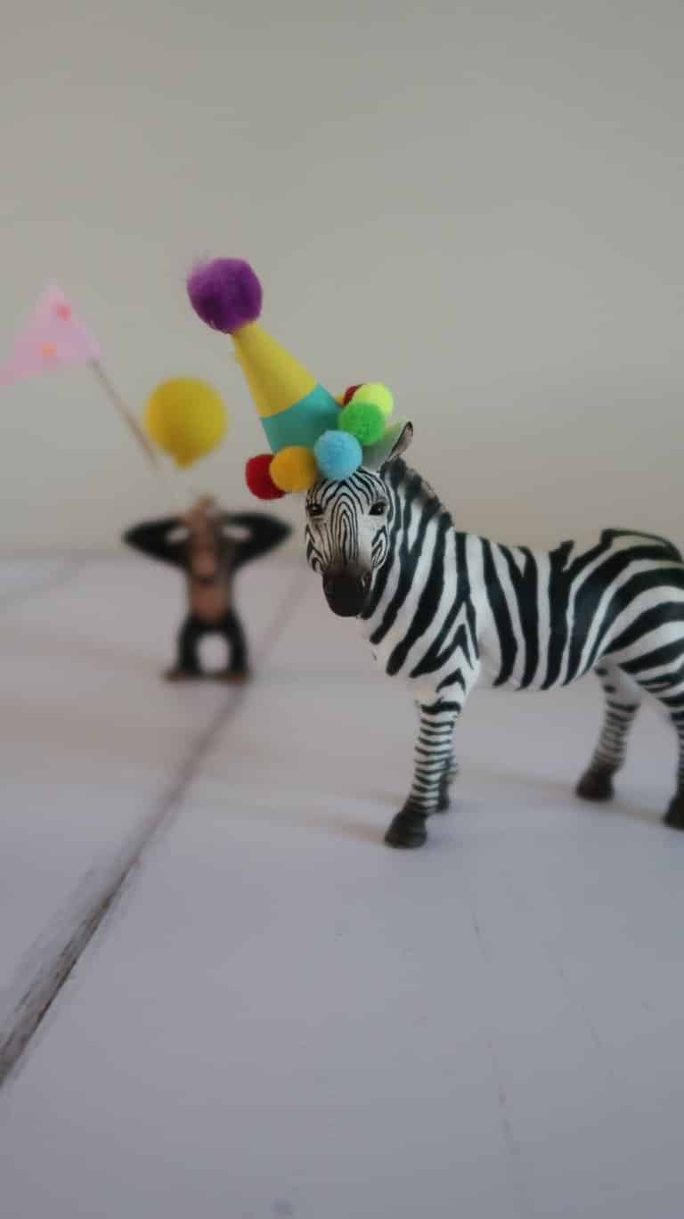 DIY toy zebra party animal wearing homemade party hat